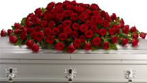 Last Great Love Red Rose Casket Spray from Sympathy Flower Shop. This loving, flowing embrace of rich, regal roses in an all-red sympathy spray can adorn the casket cover spray.  Our full spray of red crimson roses is designed beautifully for one last farewell. SKU SYM801