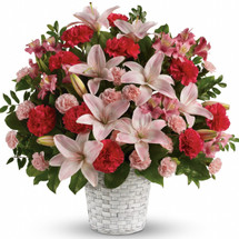 Sweetest Love Funeral Basket by Sympathy Flower Shop. The radiant bouquet includes pink asiatic lilies, pink alstroemeria, hot pink carnations and pink miniature carnations accented with assorted greenery delivered in a white pot basket. SKU SYM430