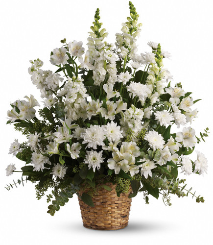 Heavenly White Funeral Basket by Sympathy Flower Shop. White alstroemeria, snapdragons and stock in a beautiful basket is a heartfelt gift of caring that brings an air of serenity to the memorial service. SKU SYM433