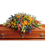 Colorful Sunflower with Orange Lilies & Yellow Roses Casket Spray from Sympathy Flower Shop. This sympathy casket cover includes green hydrangeas, orange roses, yellow spray roses, large yellow sunflowers, red gladioli, orange asiatic lilies, blue delphinium, orange snapdragons, light yellow stock, and yellow button spray chrysanthemums are accented with green trick dianthus, blue eryngium, bupleurum, dusty miller, and various greenery. SYM806