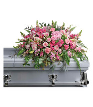 Loving Memories Pink Rose and Stargazer Lilies Casket Spray from Sympathy Flower Shop. This statement making sympathy spray features pink hydrangeas, pink stargazer lilies, pink roses, pink spray roses, pink larkspur, pink snapdragons, pink carnations, pink stock, and various greenery including  eucalyptus, sword fern, and more. SYM808