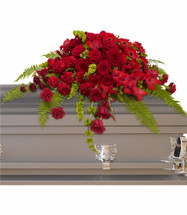 Sanctuary All Red Casket Cover Half Spray from Sympathy Flower Shop. This classic casket cover spray includes beautiful red roses, red spray roses, red gerberas, red gladioli and red carnations along with vibrant green bells of Ireland create a sincere tribute. SKU SYM820