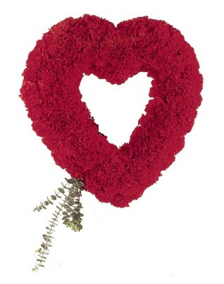 "Forever Loved Heart Shaped Red Carnation Sympathy Spray from Sympathy Flower Shop. An open-center heart arrives on an easel covered with red carnations accented with eucalyptus. Heart is approximately 21"" W x 28"" H SKU SYM109"