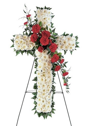 """Red Carnation Funeral Flower Cross from Sympathy Flower Shop. The funeral spray includes the sympathy cross covered in  white chrysanthemum flowers with a cluster of red carnations through the center and arrives on a funeral easel. Approximately 22"""" W x 34"""" H  SKU SYM305"""