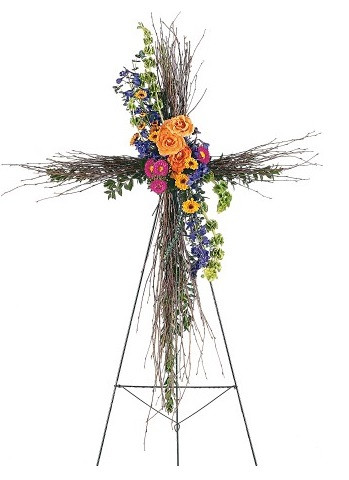 """Compassionate Care Birch Funeral Cross of Bright Flowers from Sympathy Flower Shop. The natural birch cross on an easel arrives with a cluster of vibrant fresh flowers including hot pink asters, orange roses and blue delphinium. Approximately 32"""" W x 50"""" H SKU SYM307"""
