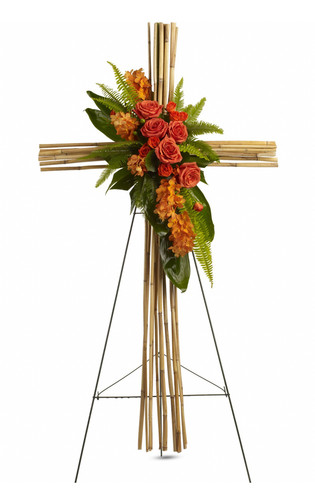 "Orange Roses River Cane Sympathy Flower Cross from Sympathy Flower Shop. This natural river cane cross is adorned with a brilliant display of flowers and greenery, such as orange mokara orchids, orange roses and spray roses, green ti leaves, umbrella and sword fern and galax leaves, all in an arrangement that is as exceptional as it is beautiful. Approximately 28"" W x 50"" H  SKU SYM308"
