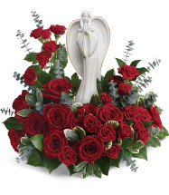 "Red Roses with White Angel Keepsake Sympathy Arrangement from Sympathy Flower Shop. Our radiant bouquet includes 12 red roses, red spray roses, spiral eucalyptus, variegated pitt, and lemon leaf. Approximately 15"" W x 14"" H SKU  SYM402"