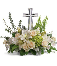 "Glorious Love Large Crystal Cross with All White Funeral Flowers from Sympathy Flower Shop. Your funeral flowers will arrive with green hydrangea, crème roses, white lilies, white alstroemeria are accented with sword fern, spiral eucalyptus, and lemon leaf. Funeral flowers are approximately 22"" W x 18"" H. SKU SYM450"