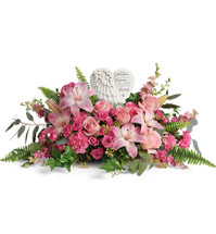 "Heaven's Heart Keepsake with Pink Roses and Lilies from Sympathy Flower Shop. This heartfelt bouquet includes pink roses, pink spray roses, pink lilies, pink carnations, pink larkspur, seeded eucalyptus, silver dollar eucalyptus, and sword fern. Your sympathy flowers include the Heaven's Heart Keepsake, approximately 6""H x 6""W. Heart scripture read, ""Because someone we love is in heaven, there is a little bit of heaven in our hearts.""  SKU SYM460"