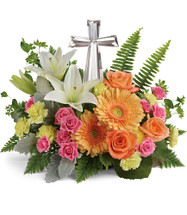 "Pink and Orange Crystal Cross Funeral Flower Arrangement from Sympathy Flower Shop. Funeral flowers include pink spray roses, white lilies, light orange gerberas, and yellow miniature carnations are accented with galax leaves, sword fern, and leatherleaf fern. Delivered with the small Crystal Cross keepsake, cross is approximately 7""H x 4""W x 1.5""D. Sympathy flowers are approximately 15"" W x 13"" H SKU SYM465"
