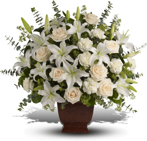 Loving White Lilies and Roses Bouquet by Sympathy Flower Shop.  It includes white lilies, white roses, white carnations and eucalyptus in a ceramic urn.  Houston TX Funeral Florist SKU SYM401