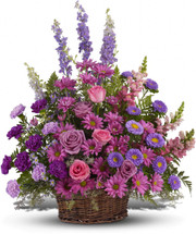 Gracious Love Purple Funeral Basket by Sympathy Flower Shop. A profusion of purples, pinks and lavenders such as roses, carnations, larkspur, matsumoto asters and monte cassino asters are delivered in a round wicker basket. Top Houston funeral florist. SKU SYM420