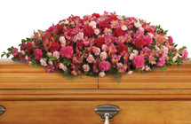 Loved Life Shades of Pink Casket Cover Spray from Sympathy Flower Shop. The sumptuous floral bouquet includes dark pink alstroemeria, hot pink carnations, pink carnations and miniature light pink carnations accented with huckleberry and eucalyptus greenery.  SKU SYM818