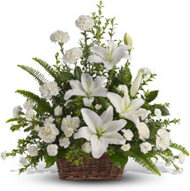 Peaceful Basket with White Lilies by Sympathy Flower Shop. Beautiful flowers such as white lilies, carnations and pixie carnations mix with vibrant greens in a large basket. Houston's top funeral florist.  SKU  SYM415