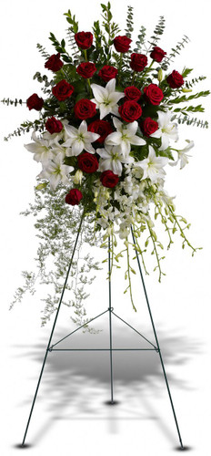Lily and Rose Tribute Spray by Sympathy Flower Shop.  A fitting tribute for any funeral service. This standing spray of lush flowers includes 20 red roses, white dendrobium orchids and oriental lilies - accented with greenery - is delivered on a funeral easel. Pearland funeral flower delivery. SKU SYM605