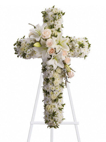 "White Lily Funeral Cross of Flowers from Sympathy Flower Shop. This cross of flowers includes crème roses, white spray roses, oriental lilies, stock, leptosporum, cushion and mums and is a beautiful way to honor a loved one. Approximately 26"" W x 36"" H SKU SYM302"
