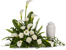"Stately White Calla Lilies by Sympathy Flower Shop. A calming portrait in ivory. Majestic calla lilies and stately white roses are framed by the lush leaves of aspidistra and calathea. Soft green sword fern adds to the soothing tones. Approximately 40""w x 31""h.  SKU SYM402"