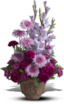 Heartfelt Purple Memories by Sympathy Flower Shop. Includes gladioli, carnations and chrysanthemums in royal hues of purple and lavender, presented in a Grecian-style urn. Your Houston funeral florist. SKU  SYM411