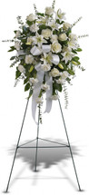 Sentimental Serenity Standing Spray by Sympathy Flower Shop. Lovely spray of classic white roses, fragrant lilies and traditional carnations decorated with white satin ribbon is a tasteful way to express your deepest sympathy and accented with eucalyptus greenery.  Free Baytown delivery for funeral flowers. SKU SYM603