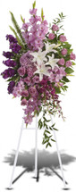 Gracious Gardens Standing Spray from Sympathy Flower Shop. Lavender, purple and white flowers like hydrangea, orchids, roses, oriental lilies and more create a beautiful spray. Bellaire funeral flower delivery.  SKU SYM617