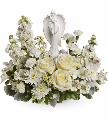 """Pure White Flowers and Angel Keepsake Sympathy Arrangement from Sympathy Flower Shop. White roses, white alstroemeria, white stock, white miniature carnations, white cushion spray chrysanthemums are arranged with white waxflower, and variegated pittosporum. Delivered with an Angel of Grace keepsake.  Bouquet size is approximately 16"""" W x 14"""" H  SYM459"""