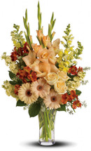 Tunnel of Light Sympathy Arrangement by Sympathy Flower Shop. Express your condolences in tasteful shades of color with peach, orange and yellow flowers in a stylish trumpet vase. For the service or the home, it is an elegant choice. SKU SYM435