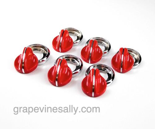 """LAST SET! Set of 6 RED vintage O'keefe & Merritt gas stove burner control knobs. Included are 6 NEW CHROMED bezels and 6 round tension washers that sit between the knob and bezel when installed. This is a very unique set.There are no cracks, chips in the plastic/bakelite, all rear """"D's"""" are in very good shape. All knobs have a brilliant shine, in excellent condition. These are all stunning and extremely rare."""