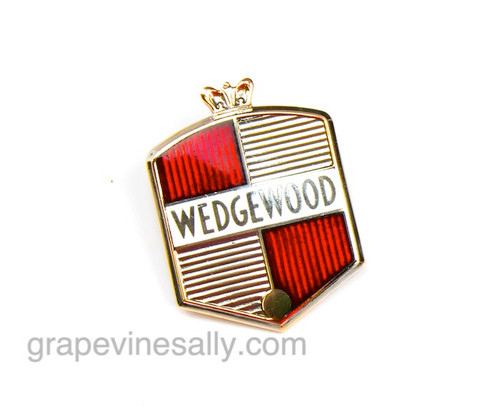 """Original Vintage Wedgewood Gas Stove Red Logo Emblem. This Logo Emblem is found on the vintage 1940's - 1950's Wedgewood stoves - it attaches with 2 rear posts. It is in good used condition. It is a beautiful detail piece that attaches to the rear stove back splash and on some models and the front knob control panel. If you are restoring a vintage Wedgewood, you may want this beauty. Attaching nuts are included.   MEASUREMENTS: 2.25"""" tall x 1.75"""" wide"""