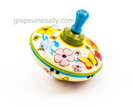 "Vintage 1960's working spinning top tin toy. Great colorful graphics. MEASUREMENT: 5.5"" Diameter"