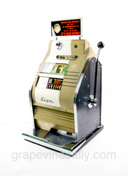 "This is a working Vintage MAD MONEY Slot Machine. It works beautifully and been recently serviced. There are a few small paint chips on the front (see photos) Very nice all original condition. Rear panel locking keys included.   MEASUREMENTS:  H 32""  /  W 17""  /  D 18""  NO SHIPPING. These machines are very heavy. Pick up at our Ventura shop. Contact to make appointment."