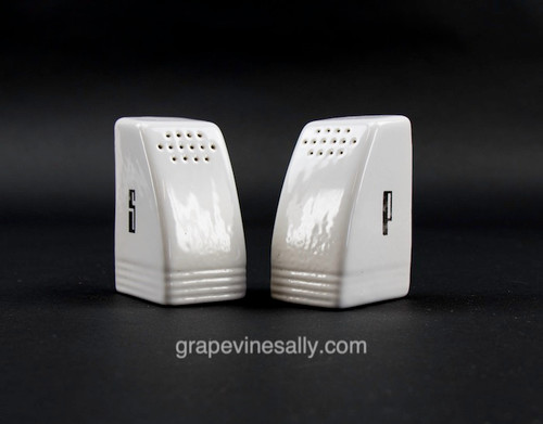 "Original Vintage Gas Stove White Ceramic Salt & Pepper Shakers. Can sit in your stove top clock base. These are in very nice condition, no chips, cracks or stains. The 'S' and 'P' lettering is in excellent condition.   MEASUREMENTS: (each shaker) Width 2.0""  /  Depth 1-5/8""  /  Height 3.0"""""