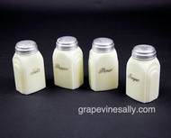 "EXTREMELY RARE. This set is a full set of 4 original vintage antique 20's-30's stove yellow green glass Salt, Pepper, Sugar and Flour shakers. These are depression era shakers that often sat in the two L&R 'cubbies' in the rear backsplash panel. To find a full set of 4 together and free of any chips, cracks or unusual stains and with all caps and lettering in good shape is extremely rare. These are the original shakers that came with the vintage stoves. This set is in extremely nice condition. MEASUREMENTS: H - 4-1/4""    W - 2-3/8""    D - 2.0"""