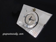 """Original Vintage 1940's, 1950's Wedgewood Gas Stove Built-In Clock Cooking Timer Assembly with New Chrome Mounting Back Plate.  MEASUREMENTS: Mounting Plate - Width at Top 7.0""""  /  Width at Bottom 6.0""""  /  Height 5.5""""  -  Rear Black Clock Housing: 6-7/8""""w x 4-3/4""""h  The clock motor works. We do not know if the clock/timer works, they most always need additional TLC. This is the original assembly that mounts on the center of the stove backsplash. The mounting back plate has new chrome. The clock timer face glass crown/cover has no scratches, cracks or chips, the red ink is all in good shape, with slight yellowing from age. All 3 white plastic knobs are intact and in good condition - all turn with the 'hands' as originally intended. We recommend you re-wire, just to be safe, the wiring looks like its best days are in the """"rear-view"""". All nooks and crannys have been thoroughly cleaned - it is 'spotless'.   - These are very old original classics, please do not purchase if you are expecting a """"plug in"""" working clock/timer unit, we do not know if it works. It is for """"tinkerers, collectors, restorers, and appreciators"""" of vintage Americana and I believe with the proper expertise and patience, anything is possible."""