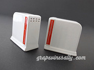 "Two Used Vintage Deco Style White & Red Salt & Pepper Shakers. These are the heavy vintage ceramic salt & pepper shakers. Original plugs included. This set is in very nice used condition.    MEASUREMENTS (each shaker at base) Width (across front red lettering) 3.0""  /  Depth 1.50""  /  Height 3.0"""