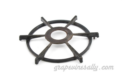 "Original Vintage Western Holly Stove Used Porcelain Enameled Stove Top Burner Grate. This is a very solid used grate. The porcelain enamel is WELL USED. A Rare Find.  MEASUREMENTS: Ring Diameter 7-3/4""  -  Outer Spoke Width 9-1/2"" -  Inner Ring Outer Diameter 3-1/4"""