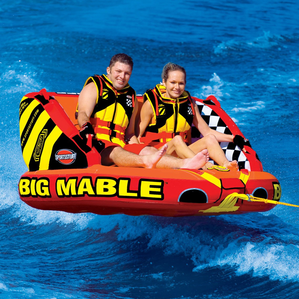 people having fun tubing in a towable tube