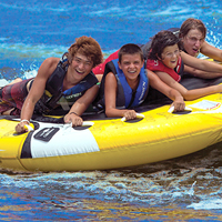 Group of people in life vests tubing in water