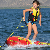 Girl in Life Jacket Tow Tubing