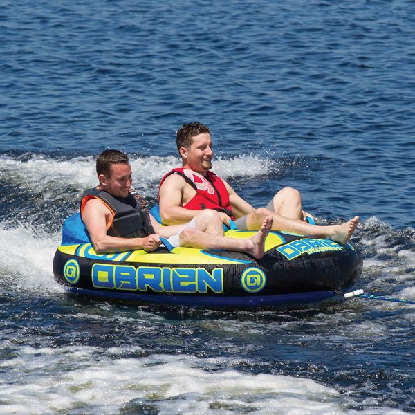2 people riding 2 person towable tube