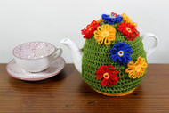 CMPATC090 Love Those Daisies Tea Cosy (4 Cup) decorated with brightly coloured daisies constructed on a daisy wheel