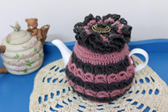 CMPATC093  Crocheted teacosy for 4 cup pot featuring bands of contasting broomstick crochet.