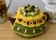 CMPATC094 Crocheted 2 cup tea pot cosy featuring bands of beaded broomstick crochet.