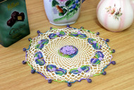 CMPATC096 Crocheted circular jug cover with roses and leaves