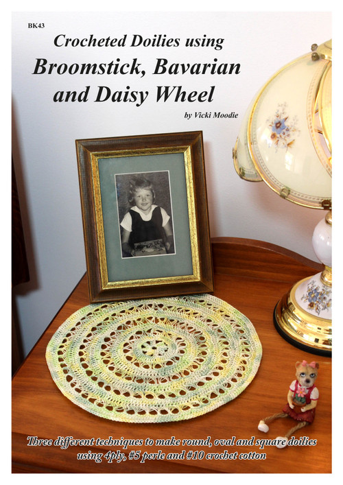 Front cover of Craft Moods publication BK43 (A4), Crocheted Doilies using Broomstick, Bavarian and Daisy Wheel, by Vicki Moodie (Australian), three different techniques to make round, oval and square doilies using 4ply, #5 perle and #10 crochet cotton.