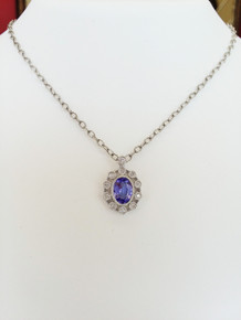 14K White Gold Oval Tanzanite & Bezel Set Diamond Halo Pendant 0.09 DTW (chain not included)