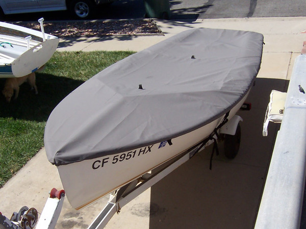 Vagabond 14 Sailboat Top Deck Cover made in America by skilled artisans at SLO Sail and Canvas. Cover shown in Polyester Charcoal Gray. Available in 3 fabrics and many color choices.