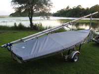 Vanguard 15 Sailboat Hull Cover made in America by skilled artisans at SLO Sail and Canvas. Cover shown in Top Gun Seagull Gray. Available in 3 fabrics and many color choices.