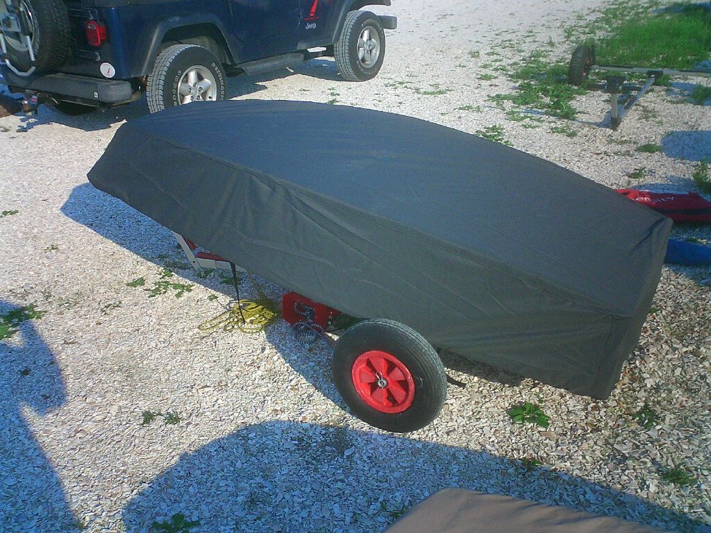 Optimist Hull Cover shown in Sunbrella Black. Available in 4 fabrics and many color choices.