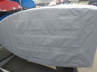 """Opti Sailboat Padded Hull Cover made in America by skilled artisans at SLO Sail and Canvas. Features (three) 1/4"""" urethane closed cell foam pads on the bottom of the cover."""