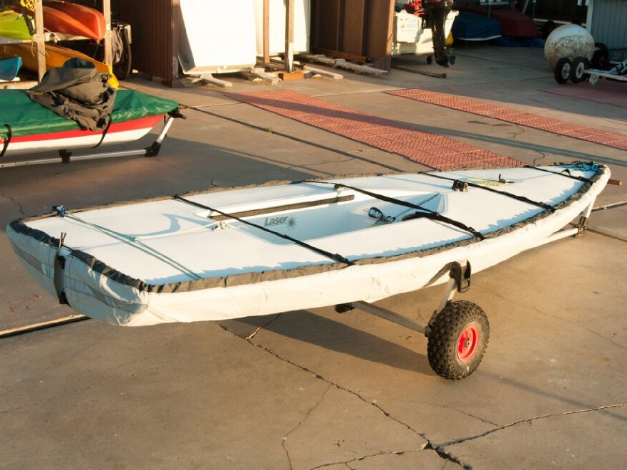 Laser Hull Cover made in America by skilled artisans at SLO Sail and Canvas. All of our covers are patterned from the actual boats they are designed to fit. This make for a better, higher quality product. Shown in SofTouch SIlver Gray.